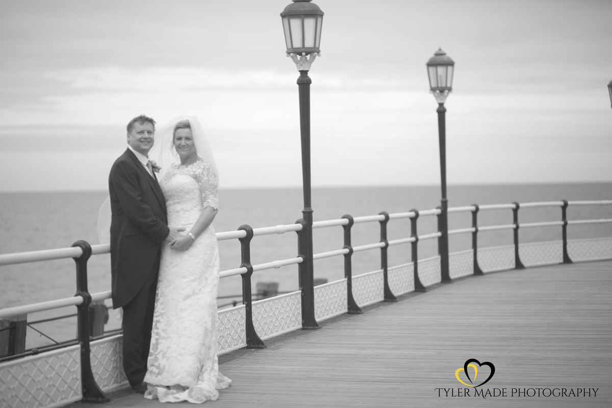 Bride and Groom cuddling on Worthing Pier by Kent Wedding Photographer Tyler Made Photography