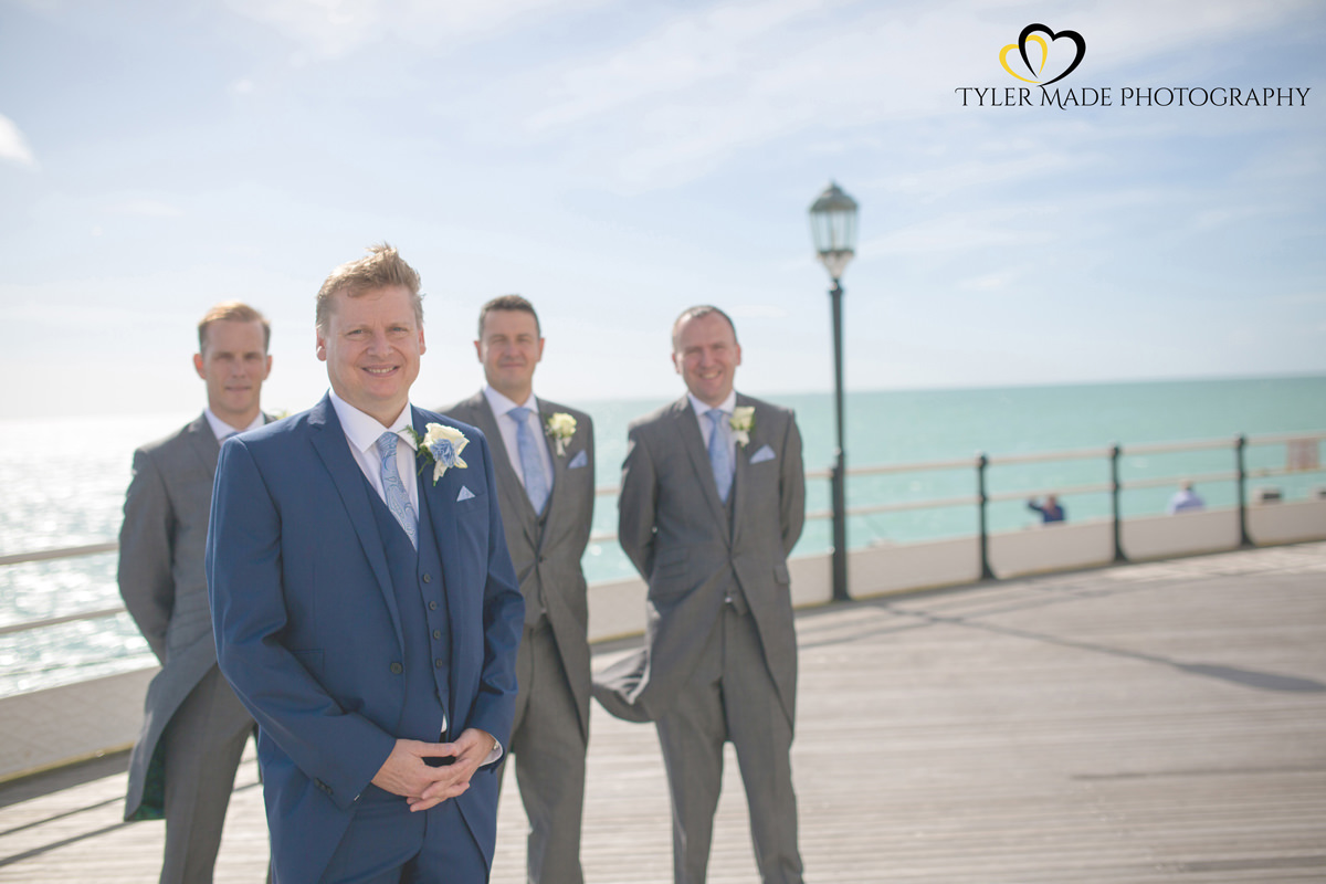 Groom and Groomsmen posing on Worthing Pier by Kent Wedding Photographer Tyler Made Photography