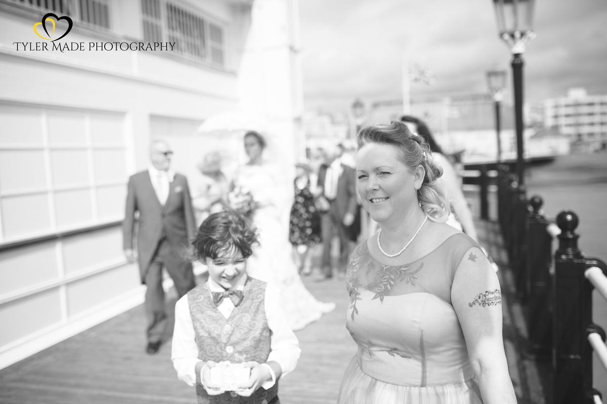 Bride walking up Worthing Pier by Kent Wedding Photographer Tyler Made Photography