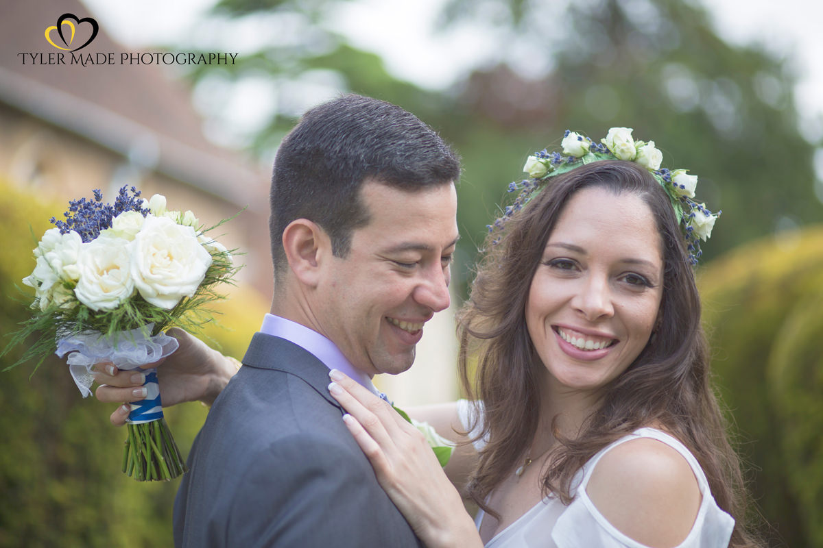 Bride and Groom posing o with flowers by Kent Wedding Photographer Tyler Made Photography