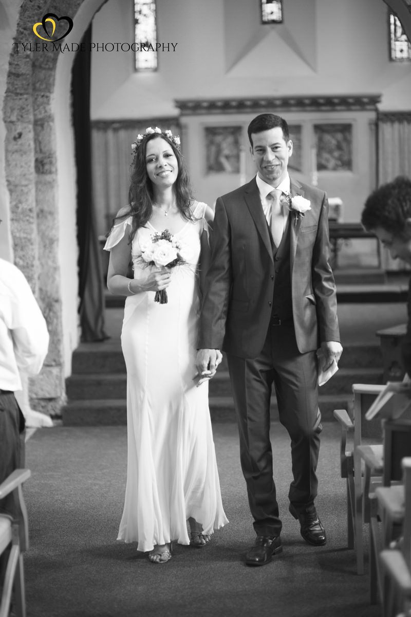 Bride and Groom Walking down the aisle in Church by Kent Wedding Photographer Tyler Made Photography