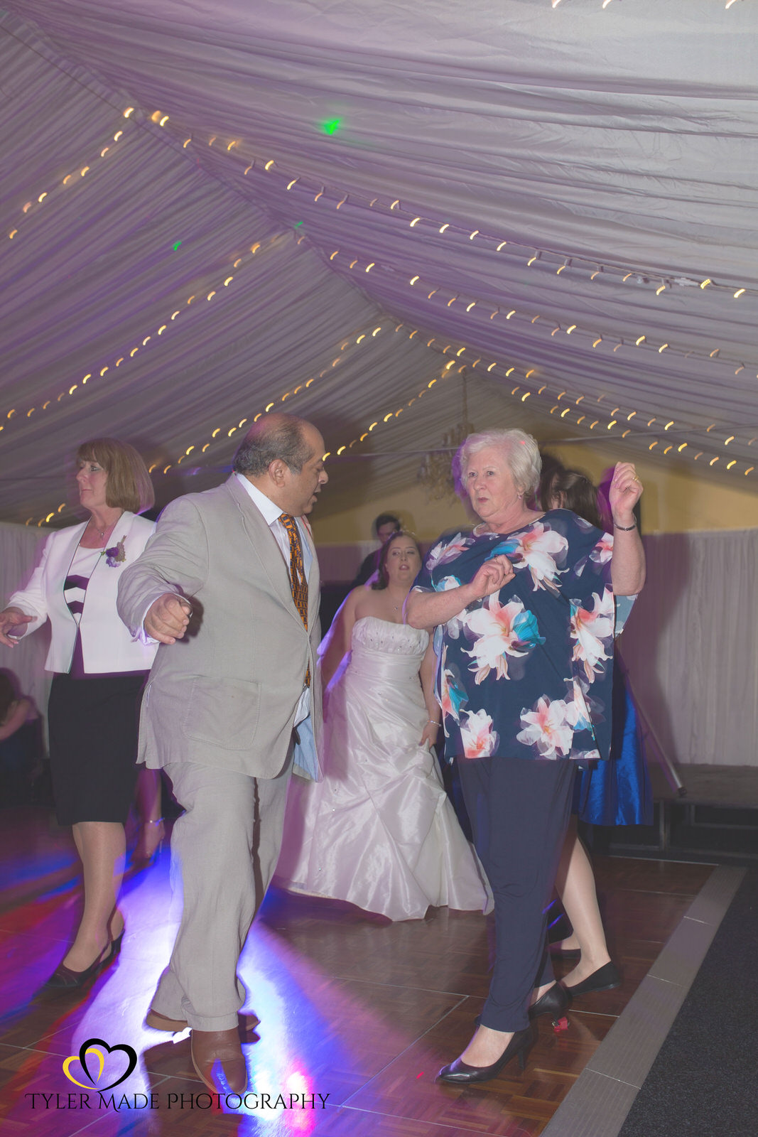 Wedding Guests dancing at The Barn, Upchurch Wedding Venue by Kent Wedding Photographer Tyler Made Photography