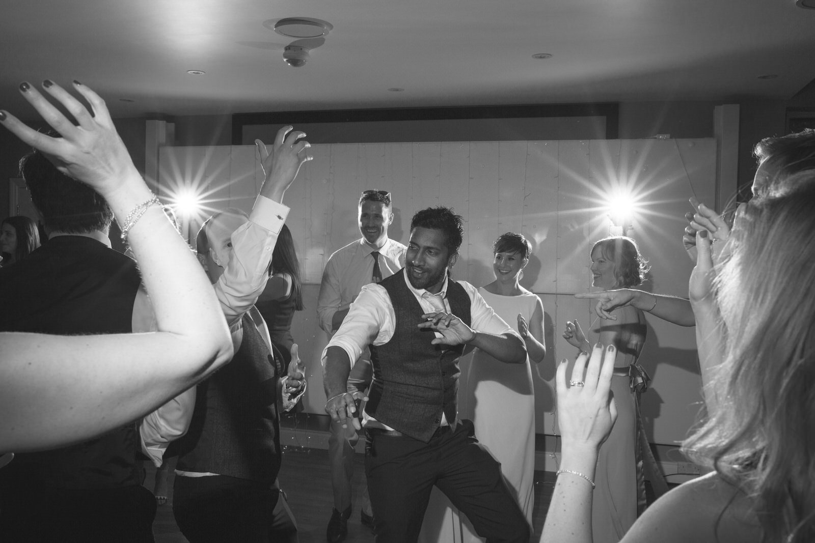 Wedding Grooms man and guests dancing at Wedding party at Hever Hotel by Kent Wedding Photographer Tyler Made Photography