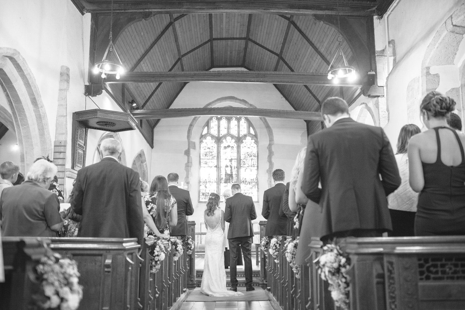 Bride and Groom in Hever Church in Kent by Kent Wedding Photographer Tyler Made Photography