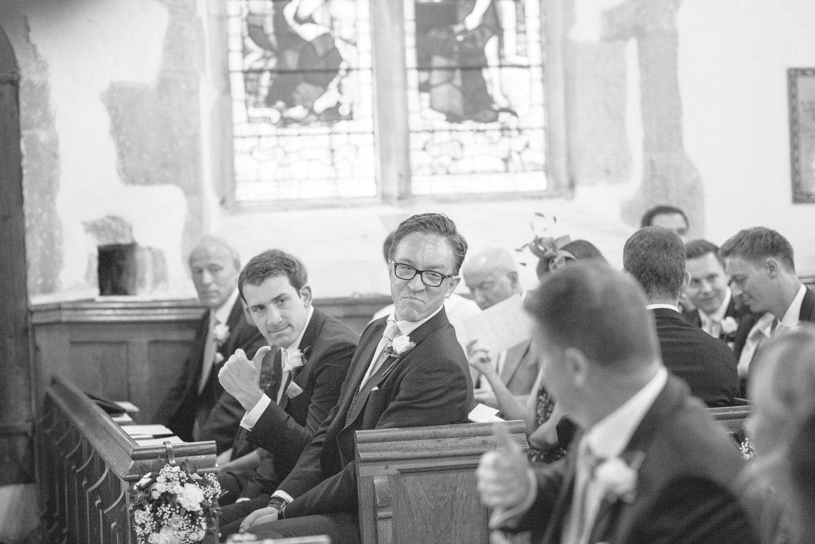 Groomsman giving the thumbs up at Hever Church in Kent by Kent Wedding Photographer Tyler Made Photography