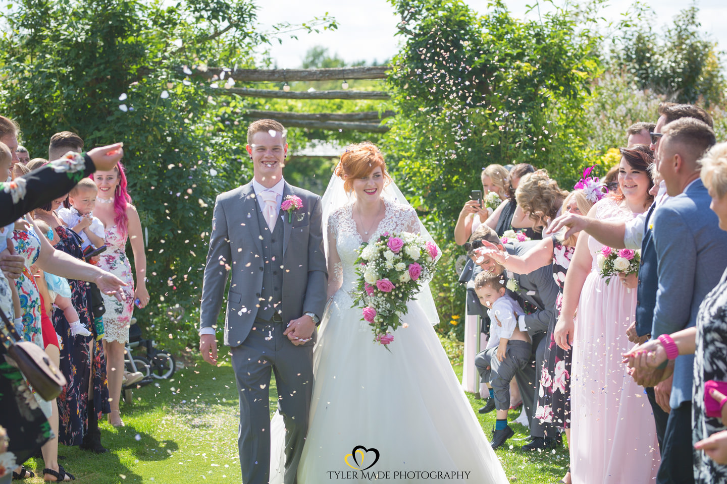 Confetti shot with bride and groom at The Gardens in Yalding