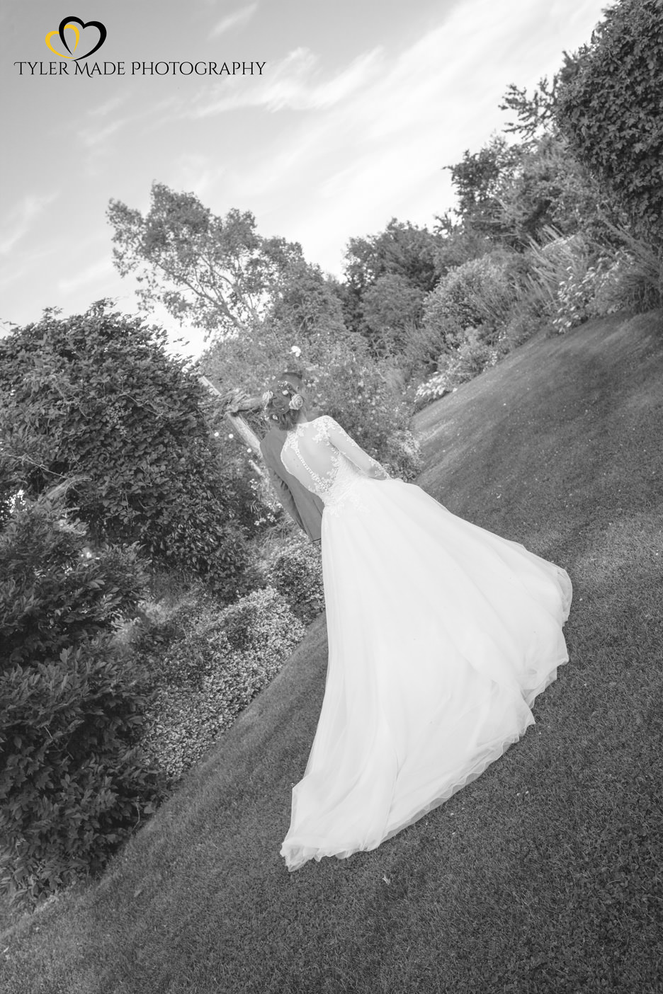 Bride being lead by the hand walking at The Gardens in Yalding