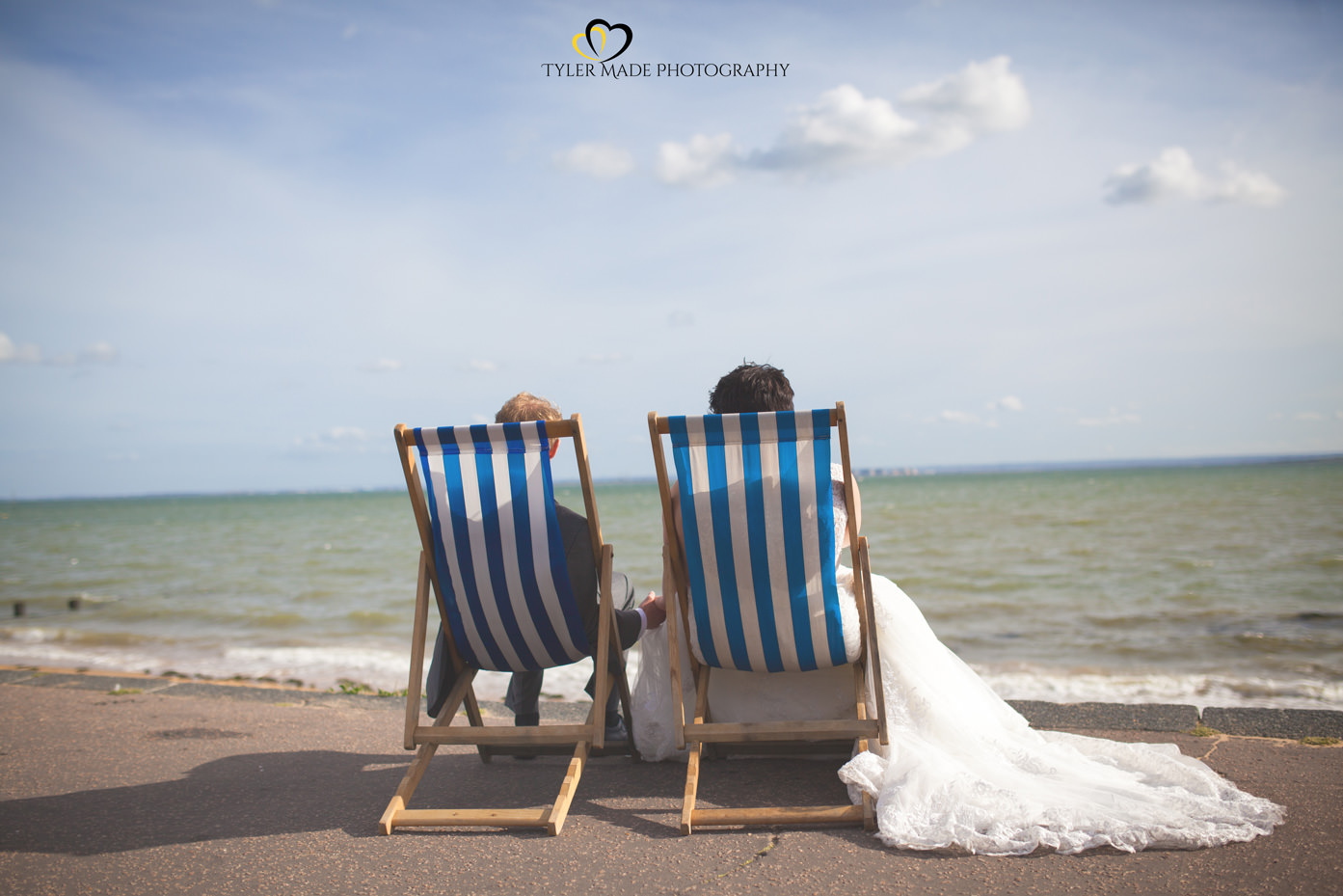 Bride and Goom on Deck Chairs