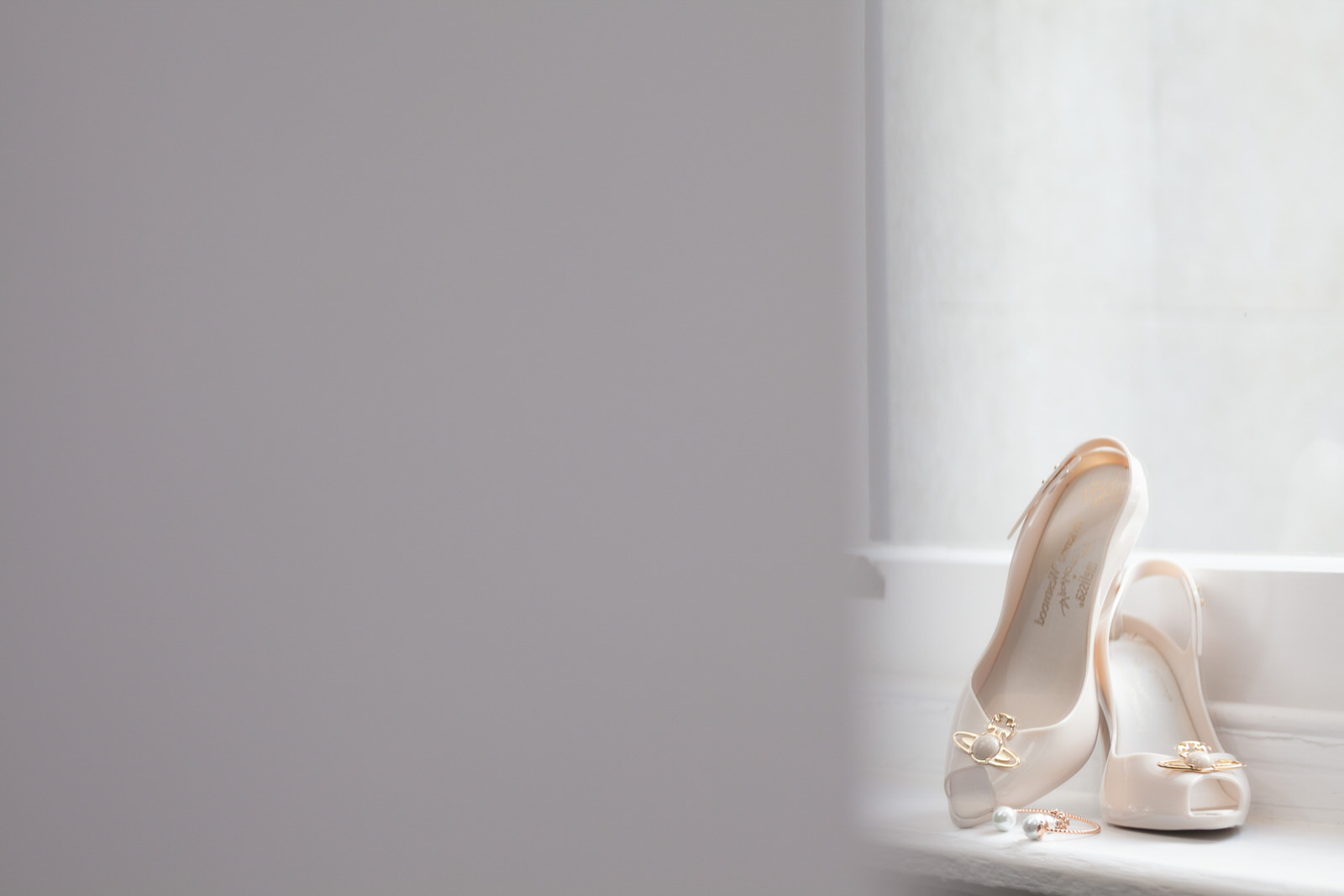 Bridal shoes on window ledge by Tyler Made Photography