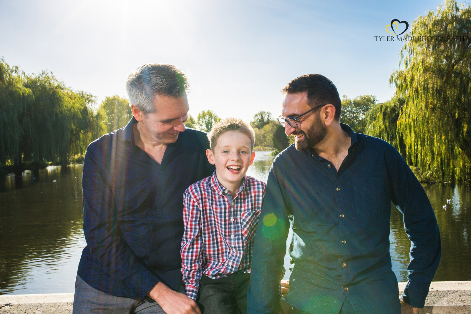 Boy and his 2 dads during a family photoshoot in London by Tyler Made Photography