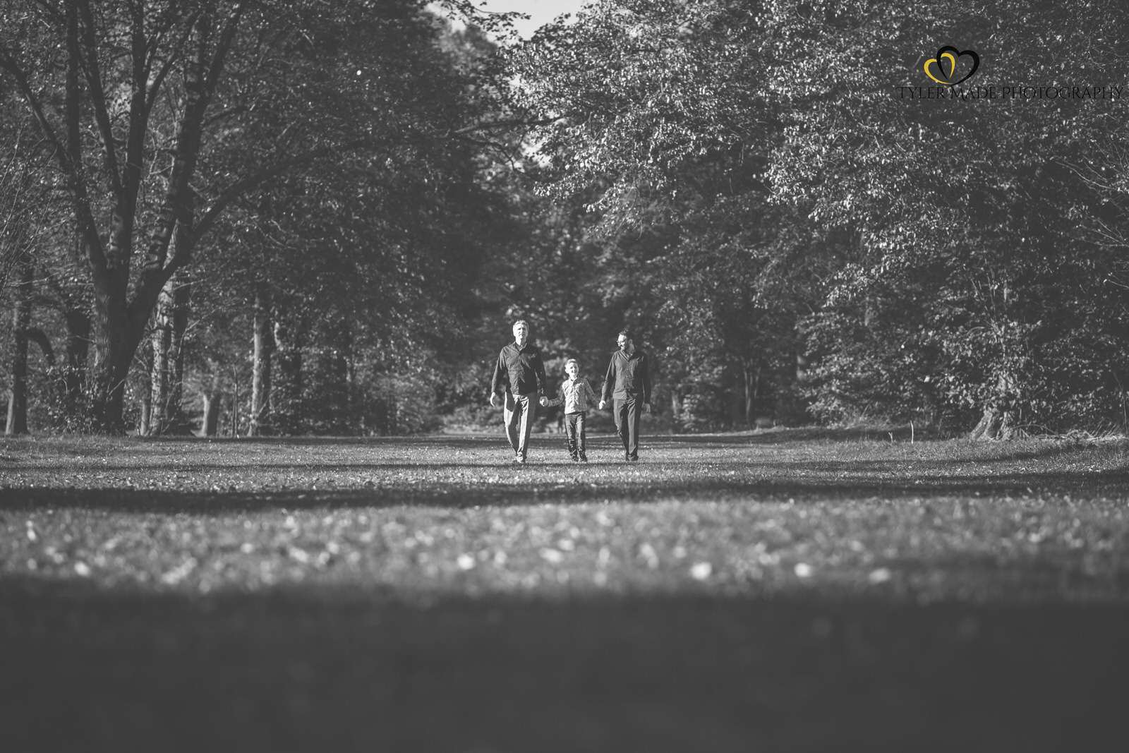 Family walking in the Park by Tyler Made Photography