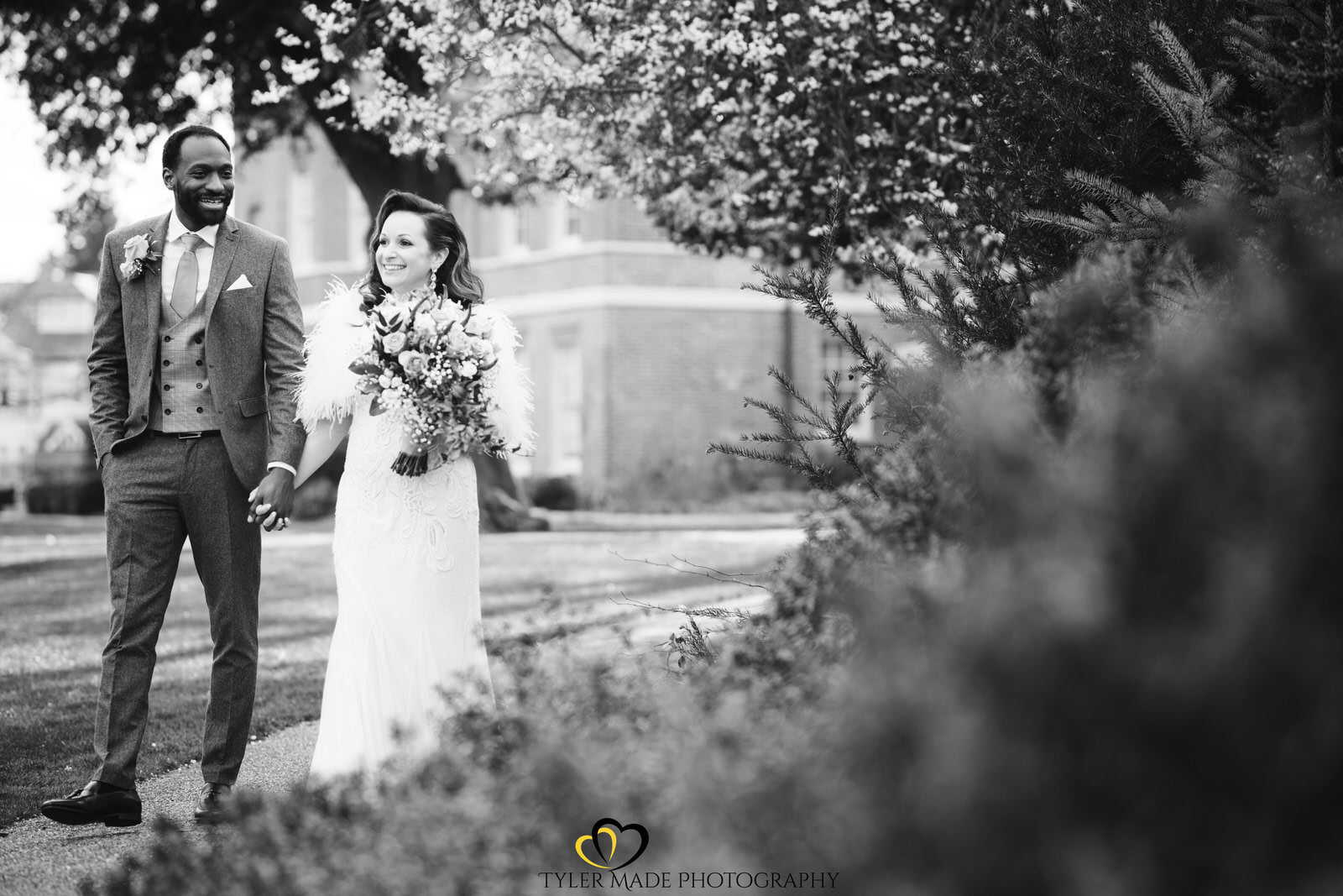 Bride and Groomtaking a gentle stroll by Kent Wedding Photographer Tyler Made Photography