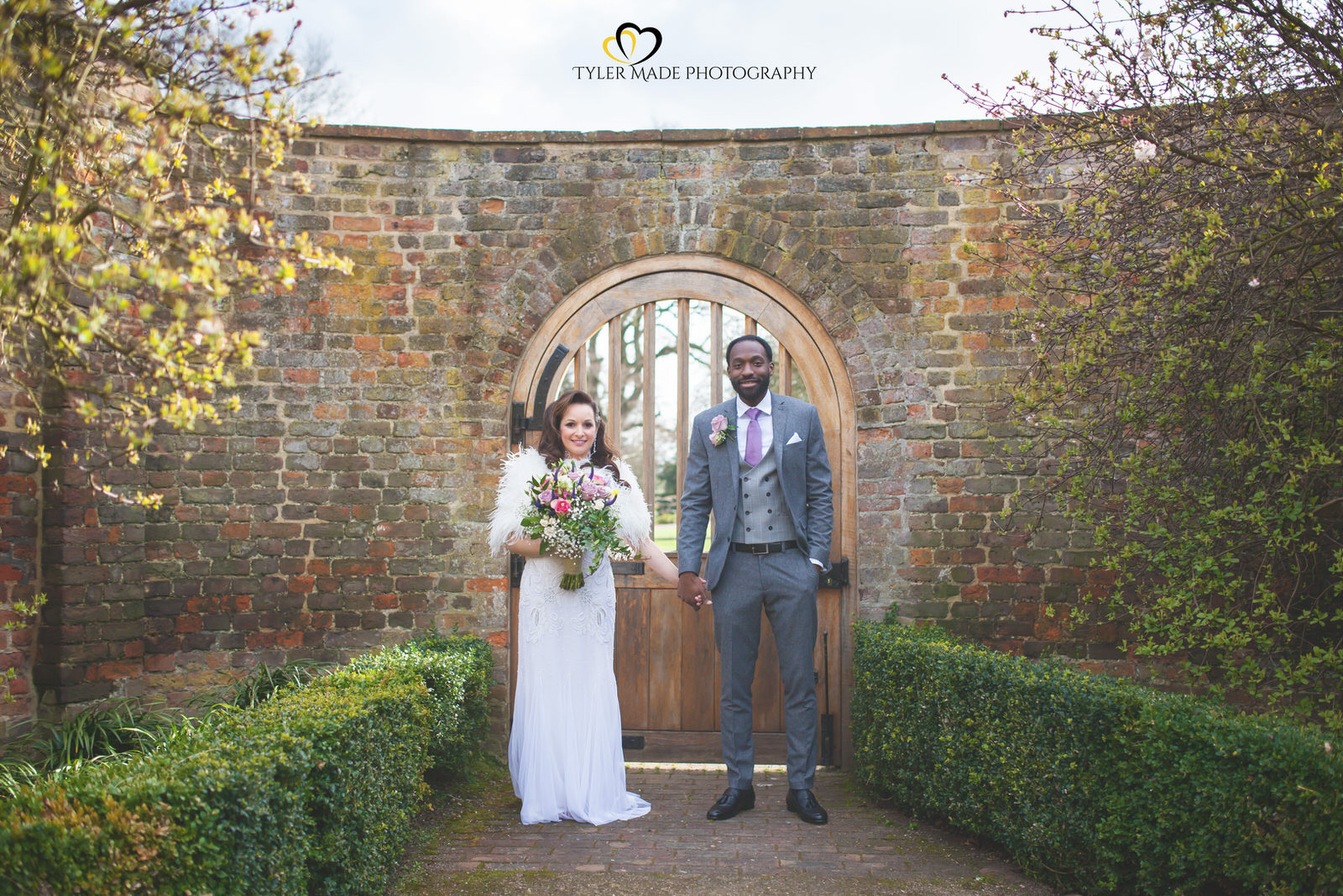 Bride and Groom posing out side Valentine Mansions Gardens by Kent Wedding Photographer Tyler Made Photography