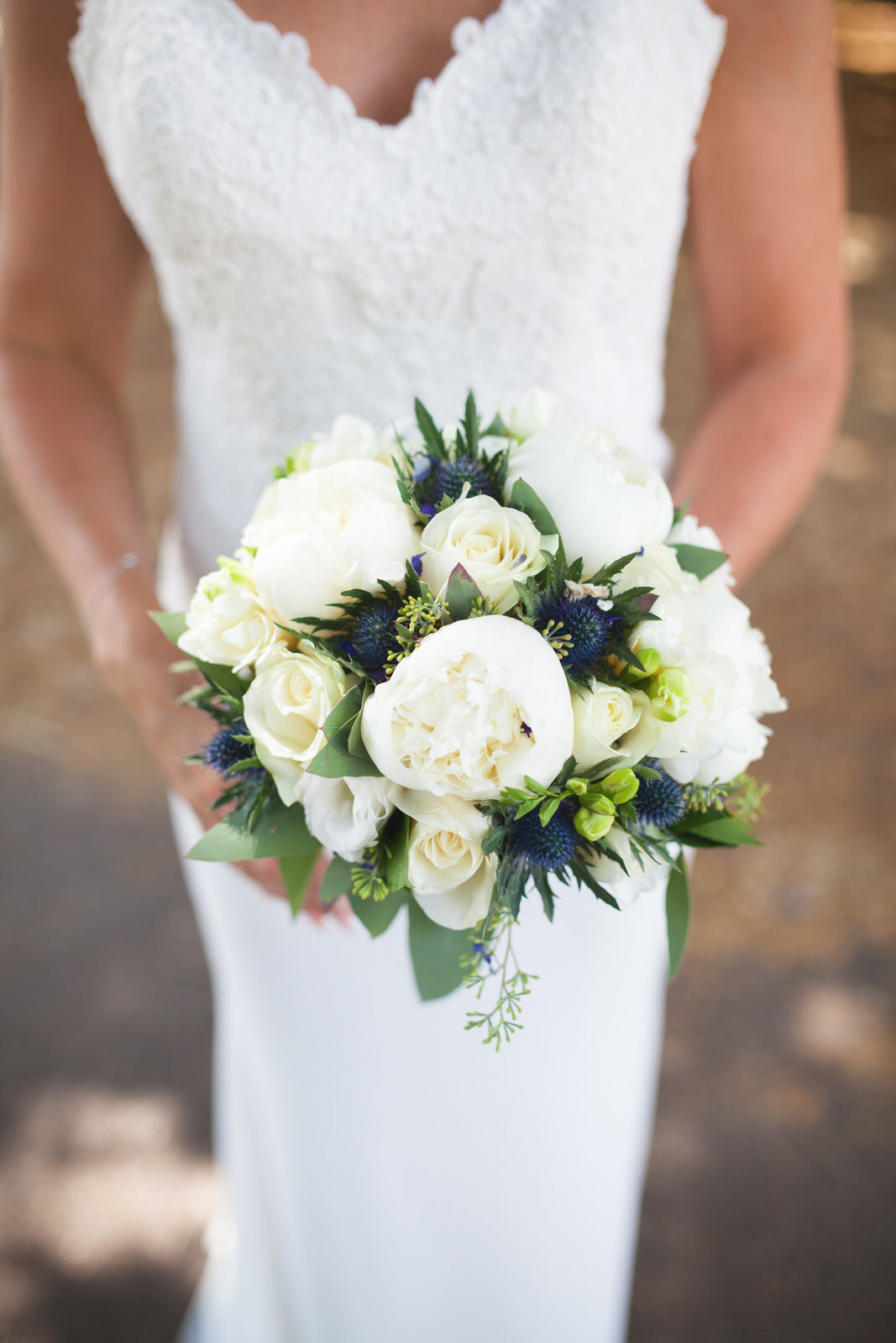 Bride and wedding flowers by Tyler Made Photography