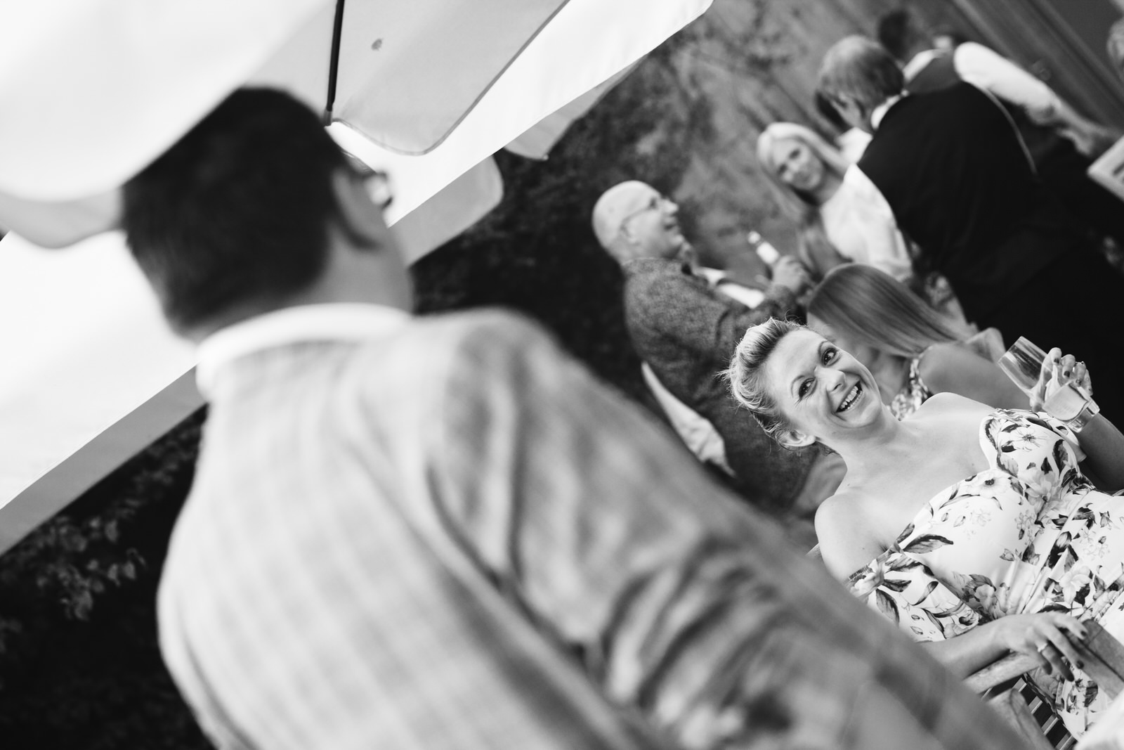 Magician at Wedding entertaining guests by Tyler Made Photography