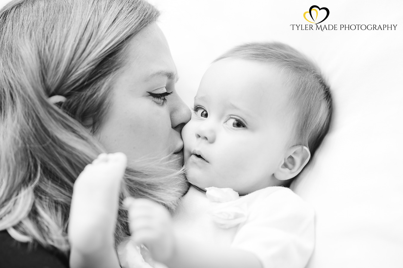 Mum kissing baby by Kent Family Photographer - Tyler Made Photography
