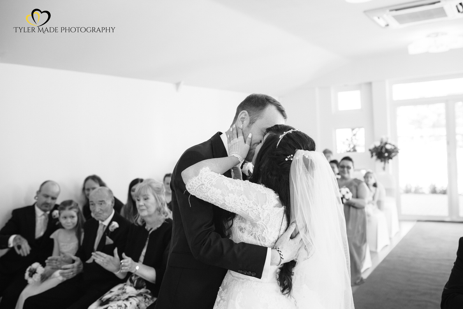 Bride and Groom having first kiss by Tyler Made Photography