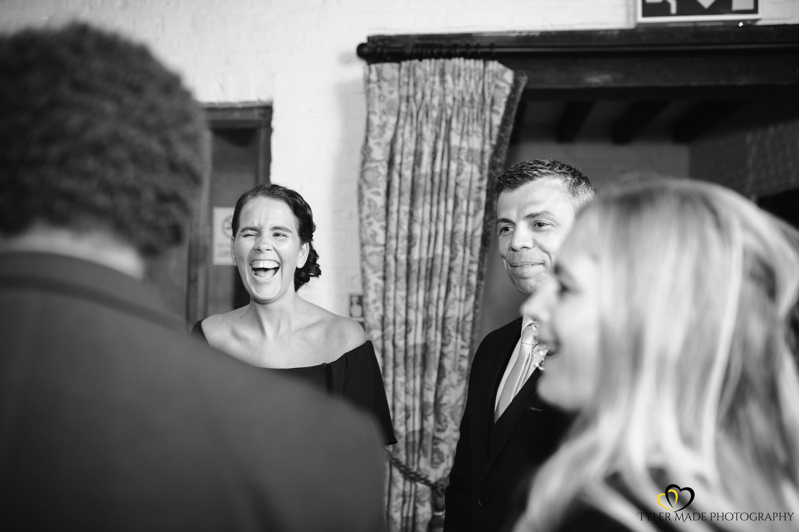 Wedding Guests Laughing at Tudor Barn Eltham - Bexley Wedding Photographer Tyler Made Photography